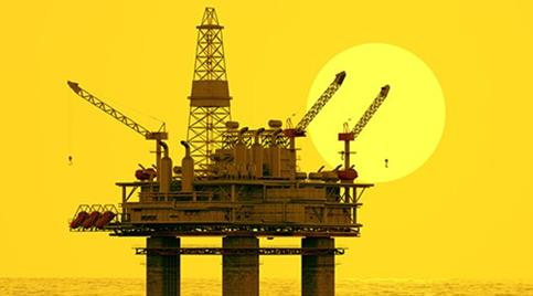 oil-rig-in-front-of-huge-moon-with-yellow-filter.jpg