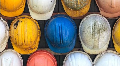 collection-of-colourful-but-dirty-hard-hats.jpg