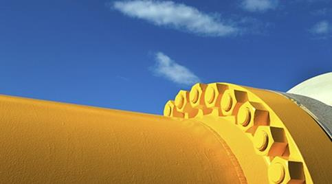 yellow-oil-pipe-on-blue-sky.jpg